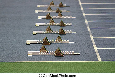 Athletics Starting Blocks on a blue running track in the...
