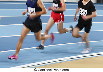 Athletics - Blured athletes run in track and field