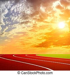 Athletics Track Lane with beautiful sky aver the sunset