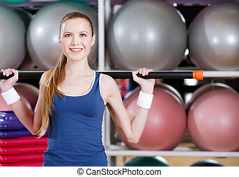 athletische, frau, arbeiten, heraus, mit, gymnastisch, stock
