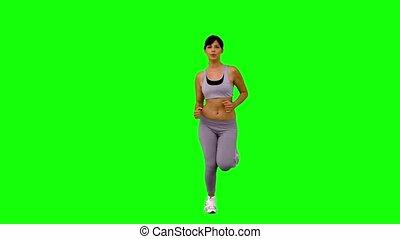 athletische, frau, jogging, auf, grün, schirm
