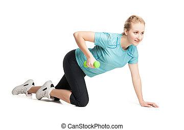 athletische, junge frau, arbeiten, heraus, mit, grün, hanteln