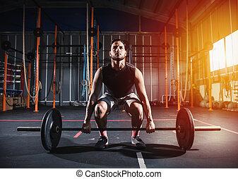 athletische, mann, arbeiten, heraus, an, der, turnhalle, mit, a, hantel
