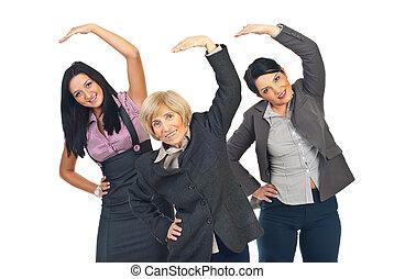 ativo, mulheres negócios, esticar, mãos