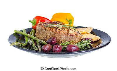 Atkins mediterranean diet. - Grilled beef on plate served...