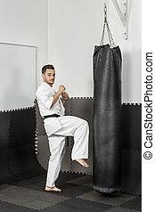 atlétikai, black derékszíj, karate, odaad, egy, erélyes, térd, megrúg