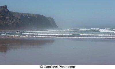 Atlantic ocean storm on sandy beach.