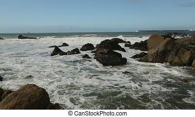 Atlantic ocean surf, splash over the stones.