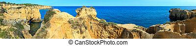 Atlantic rocky coast panorama (Algarve, Portugal).