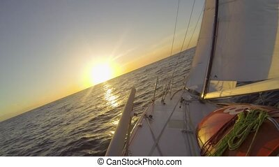Atlantic Sunset - Small racing yacht sails westbound over...