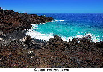 Atlantic volcanic black coast in la Palma with foam in...