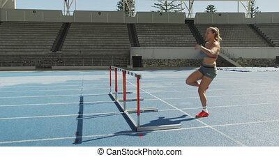 atleta, stadion, bieg przez płotki, kaukaski