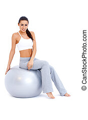 atletisch, vrouw ontspannend, op, fitheid bal