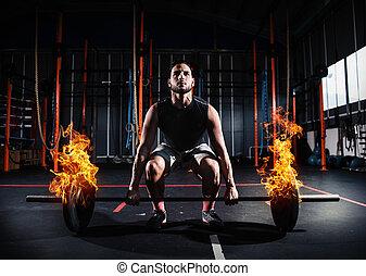 atletisk, man, arbeten, ute, hos, den, gymnastiksal, med, a, hetsande, barbell