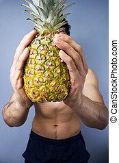 atletisk, ung man, holdingen, a, frisk, ananas