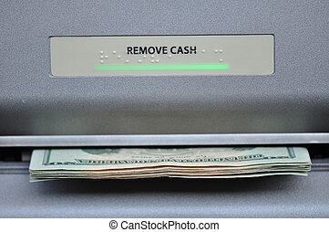 ATM Cash Machine - American cash being dispensed from a bank...