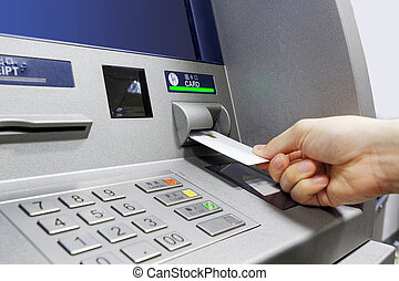 ATM insert card - male hand businessman inserts credit card ...