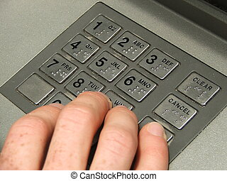 ATM keypad - Fingers typing in pin at ATM