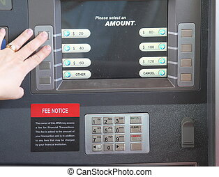 ATM Machine being used by woman