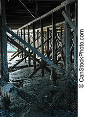 under a wooden bridge