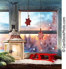 Atmospheric Christmas window sill decoration with beautiful evening view outside