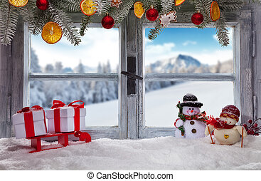 Atmospheric Christmas window sill decoration with snowy landscape outside