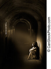 Atmospheric nude - A beam of light shines onto a nude woman