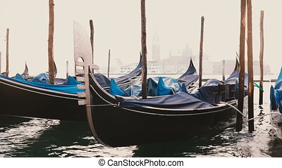 Atmospheric view of beautiful traditional gondolas rocking...