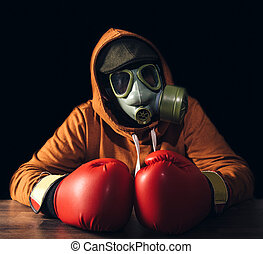 Atomic man - Portrait of scary man with gas mask and boxing...