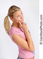 Atractive blonde woman in pink T-shirt with two plaits.