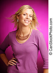 Atractive blonde woman in violet sweater