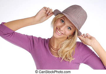 Atractive blonde woman with hat in violet sweater.