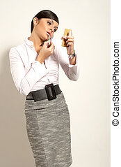 Atractive brunet businesswoman with lipstic and phone