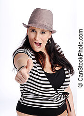 Atractive brunette woman with hat in striped black and white T-shirt