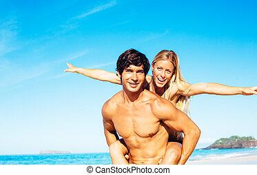 Atractive Couple Having Fun on the Beach