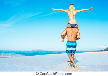 Atractive Couple Having Fun on the Beach - Happy Good...