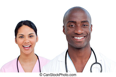Atractive smiling doctors against a white background