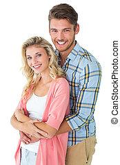 atractivo, pareja joven, sonriente, en cámara del juez