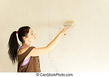 atraente, decorando, mulher, paredes, jovem