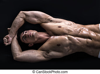 atraente, homem jovem, chão, com, muscular, rasgado, corporal