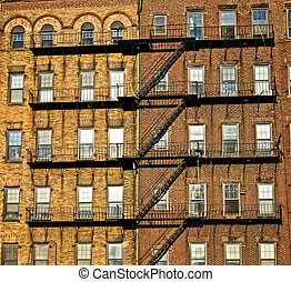 fire escapes on old tenament buildings in boston massachusetts seemingly attaching the buildings together