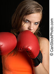 attack - boxing girl in orange shirt