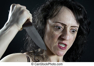 attack - crazed woman stabbing with a large kitchen knife