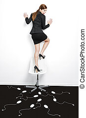 Attacked by mice - Business concept with a beautiful woman...