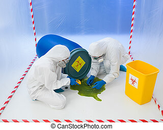 Attending to a biohazard chemical spill - Two scientists in...