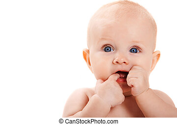 Attention - Adorable baby keeping her fingers in mouth and ...