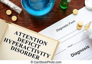 attention deficit hyperactivity disorder written on book ...