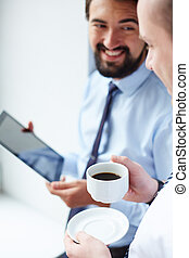 Attention - Image of young businessman holding cup of coffee...