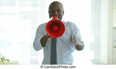 Attention, please - African-American man with megaphone...