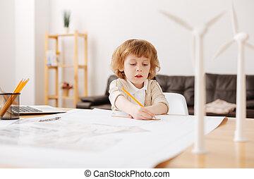 Attentive blonde man-child drawing chart